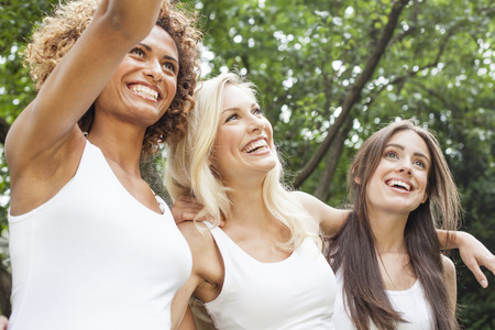 equivalents: Smiling women standing together