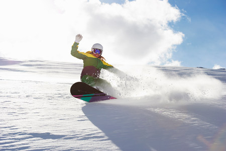 landforms: Young woman snowboarding