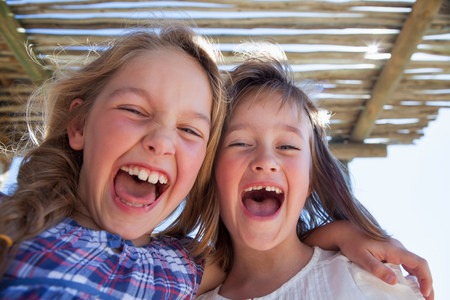 6 7 year old: Portrait of two girls shouting