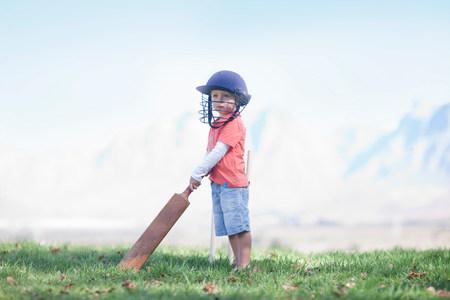 strips away: Boy with cricket bat