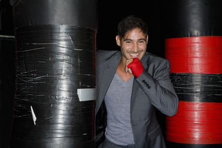 athleticism: Boxer training with punching bag LANG_EVOIMAGES