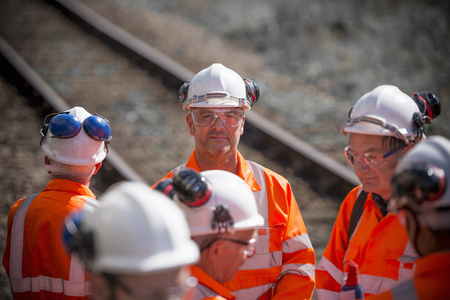 hard: Railway workers talking outdoors