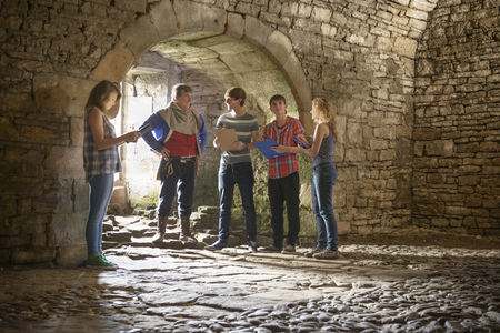sightseers: Students reading history in castle
