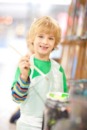 Boy with paintbrush