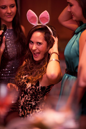 Young women wearing bunny ears at hen party