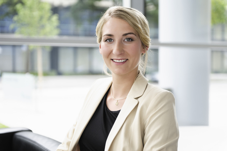 Smiling businesswoman sitting in chair