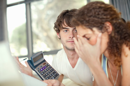 arrears: Young couple worrying over finances