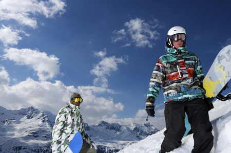 defended: Snowboarders on snowy mountaintop LANG_EVOIMAGES