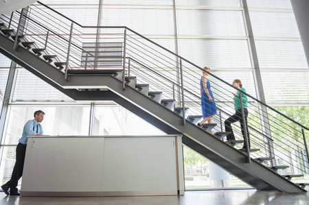 ascends: Business people walking in office