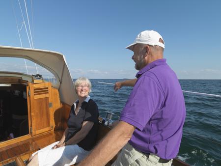 lavishly: Older couple sailing together on ocean LANG_EVOIMAGES