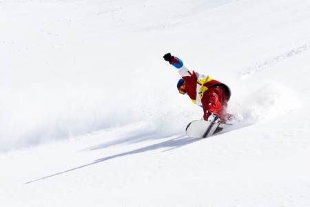 snows:  Snowboarder on snowy slope