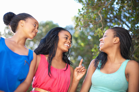 Smiling women walking outdoors
