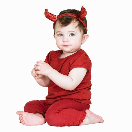 Toddler girl wearing devil costume LANG_EVOIMAGES