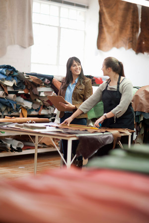 Worker and manager in leather workshop