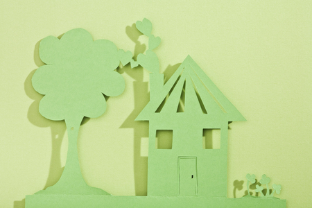 abodes: Paper cut out of house and tree