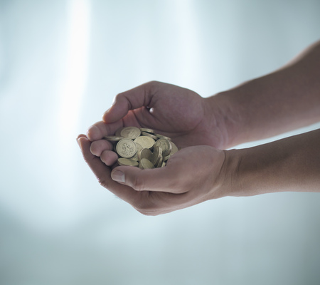 appendage: Hands holding pile of coins