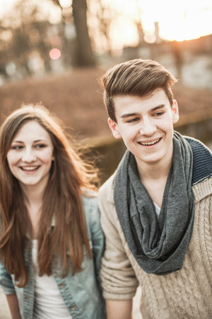 cultivating: Teenage couple standing in park