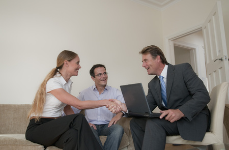 agrees: Business people talking in living room