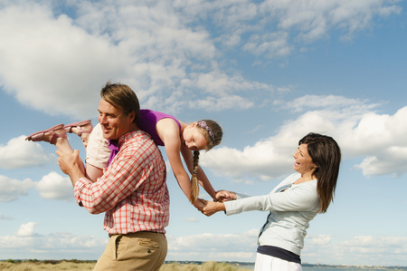 arms lifted up: Family playing together outdoors LANG_EVOIMAGES