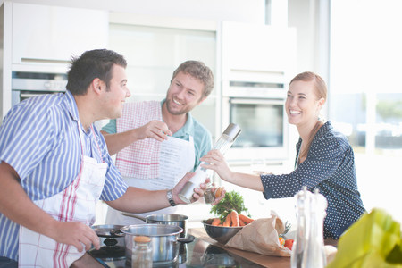 worktops: Friends cooking together in kitchen