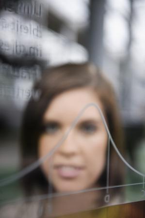 rejoices: Businesswoman examining graph