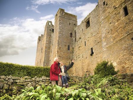 Older couple admiring castle LANG_EVOIMAGES
