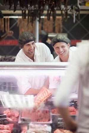 pleasurable: Male butchers working on counter