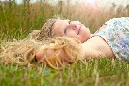 Girl lying down in a field