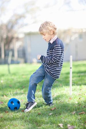 trouser: Boy playing football