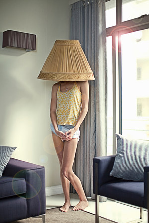 parlours: Young woman wearing lampshade on head LANG_EVOIMAGES