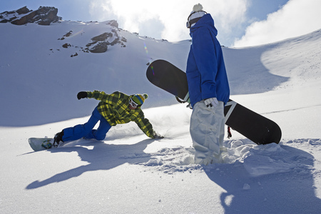 Snowboarders on snowy slope