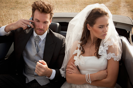 adverse: Newlywed couple arguing in car