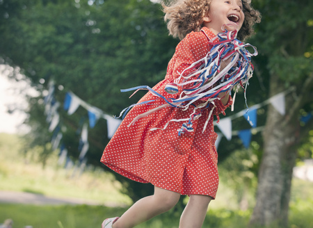 enthusiastically: Girl playing with ribbons outdoors