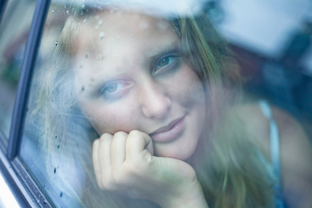 preadolescent: View of girl in a car