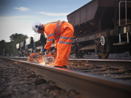 hard: Railway worker adjusting train tracks LANG_EVOIMAGES