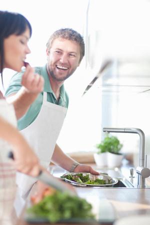 close up food: Couple preparing food,man feeding woman