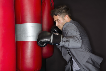 welldressed: Boxer training with punching bag LANG_EVOIMAGES