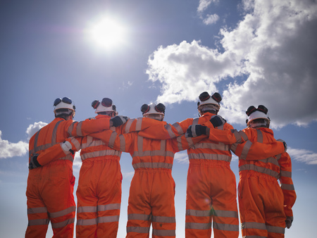 Railway workers standing together