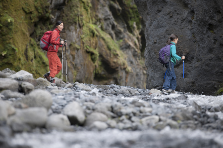 intersects: Mother and daughter hiking rocky river LANG_EVOIMAGES