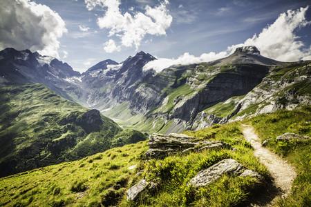 mountainous: Dirt path on grassy rural hillside LANG_EVOIMAGES