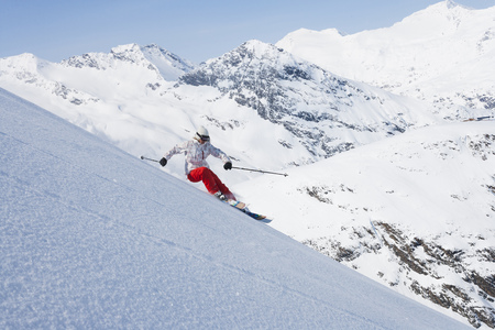 accelerated: Skier on snowy slope