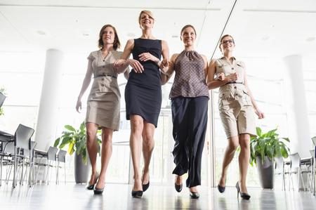 Businesswomen walking in office