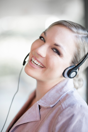joyous: Businesswoman talking on headset LANG_EVOIMAGES