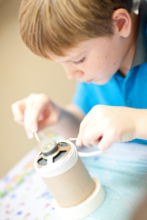 Boy making craft object LANG_EVOIMAGES