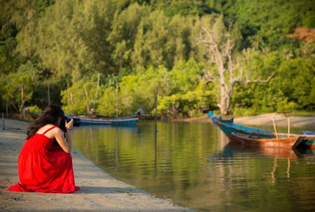 Woman photographing boats,Taling Ngam Beach,Ko Samui,Thailand
