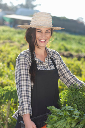 farmyards: Young woman with vegetables grown at farm