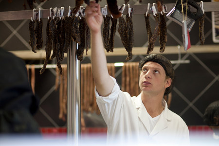 close up food: Butcher reaching up