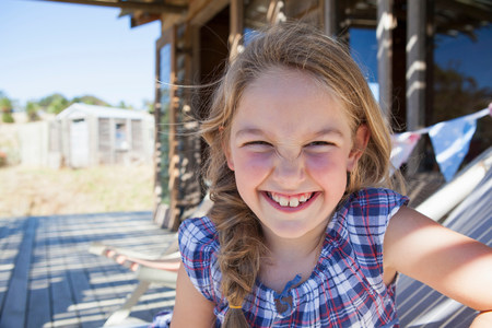 Portrait of girl wearing checked blouse,smiling LANG_EVOIMAGES