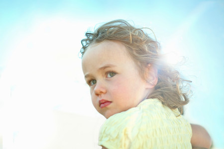 quizzical: Little girl in sunlight LANG_EVOIMAGES