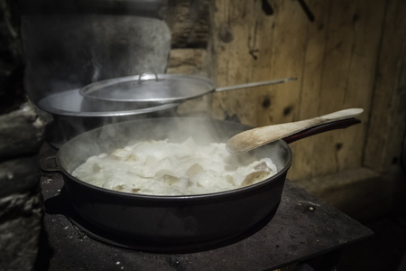 close up food: Pot of stew cooking on stove LANG_EVOIMAGES